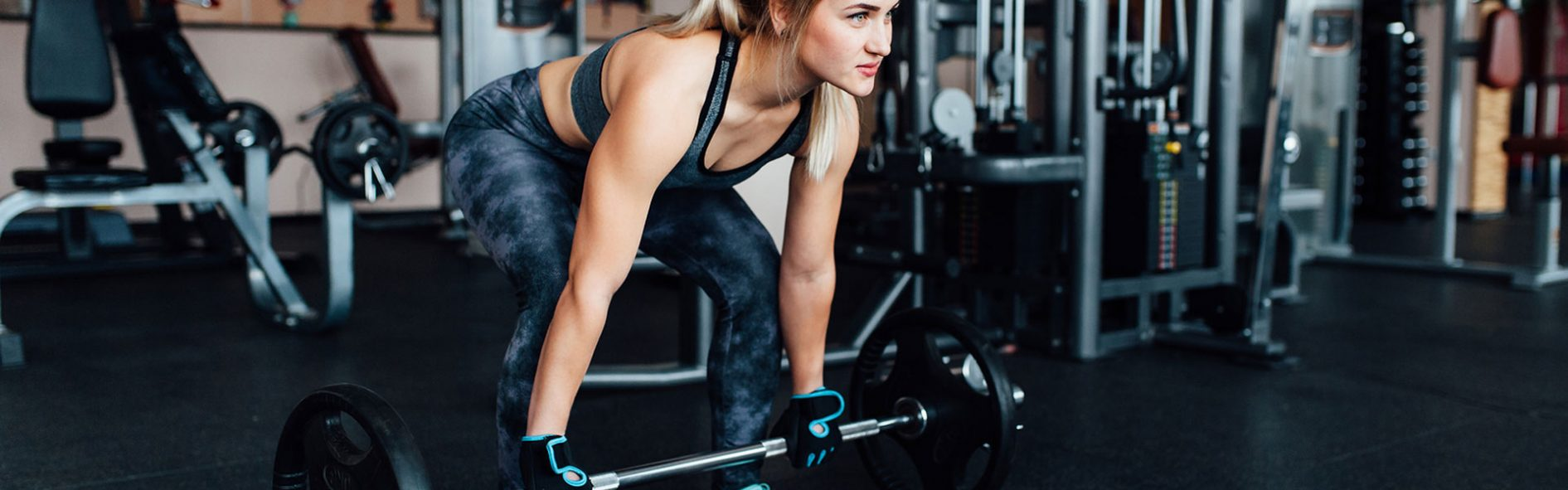 Lady Lifting Weight at Gym